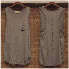 "Anchor tank top Grey/navy nautical tank top. It's a loose fitting style, with a rounded hem and racer back. The front has an anchor on the left chest area and the back says "" Hope Is the anchor of my soul"" written down the spine area. Never worn. Size S. Tops Tank Tops"