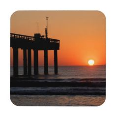 Sunrise at ocean fishing pier hard plastic coaster