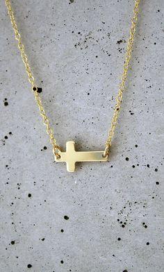 gold sideways cross necklace