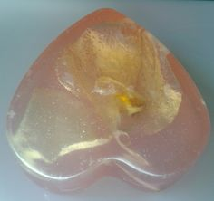 ORCHID HEART SOAP A natural glycerine soap with an embedded orchid flower, infused with Copaiba oil from the amazonian rain forest. created by C Sotto Mayor, cinemasoaps.com