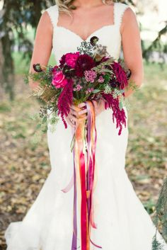 The line of the bouquet enhances the lines of the dress and her figure.