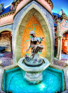 the fountain outside the Cinderella castle, where as people bend to sip from the surrounding water fountains, they also bow to the Princess :)