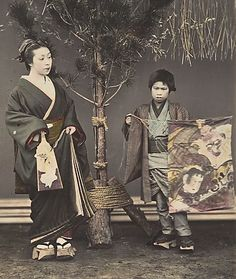Woman with her son and kite.  Hand-colored photo, circa 1870's, Japan, by photographer Shinichi Suzuki