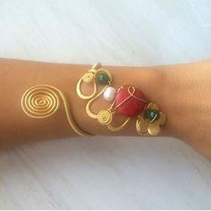 Cuff bracelet with coral wire wrapped by santorinijewellery