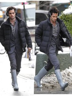 Penn Badgley on set of 'Gossip Girl' in Moncler with grey Hunter wellies, a suit and puffer jacket...way to mix up the styles!
