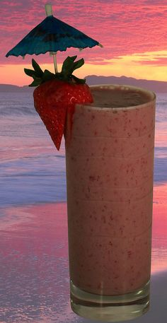Strawberry Colada! Any drink with an umbrella in it helps beat the heat. #earthbalance #vegan