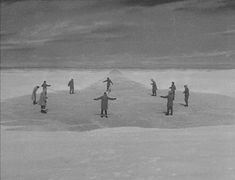 """A still from The Thing, just when they discover some thing under the ice.  """"It's round.  It's perfectly round."""""""