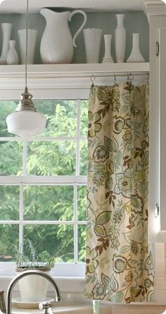 Kitchen Window Treatment: Shelf between cabinets with display items, curtain hung beneath. Love the schoolhouse light too.