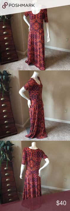 LuLaroe XL Anna maxi dress orange and navy floral LuLaroe XL Anna orange and navy floral maxi dress. Very pretty and in perfect condition. Comfortable and easy to wear and I love these colors for fall. Match with the cardigan and fun statement jewelry. Measurements by 19 inches length 60 inches LuLaRoe Dresses Maxi
