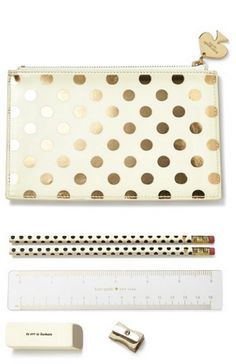Cute gold dot pouch with pencils and office must-haves by kate spade.