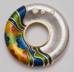 De Vroomen enamel brooch, combining platinum and gold.  It is not possible to enamel on platinum.  These brooches were made in two parts and assembled to appear as one form.