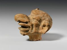 Terracotta grotesque head,Hellenistic 2nd-1st century BC Greek,Asia Minor