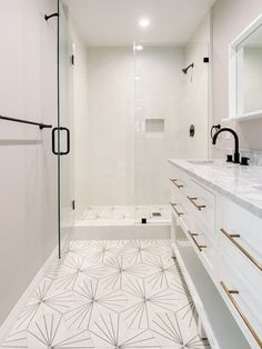 clean and modern bathroom design with linear patterned cement tiles on the floor, continuing into the shower floors. cement hexagon tiles are the perfect shape and tiles for your next bathroom project. Next Bathroom, Bathroom Renos, Bathroom Ideas, All White Bathroom, Bathroom Organization, Bathroom Renovations, 50s Bathroom, Narrow Bathroom, Budget Bathroom