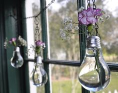 Whimsical – Light Bulb Vases, cute. Love this, probably doing it for my room.
