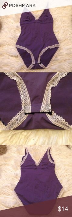 VS body suit S Worn twice. Perfect condition. Beautiful lavender color with cream lace. Great for under clothing or with jeans. Victoria's Secret Intimates & Sleepwear