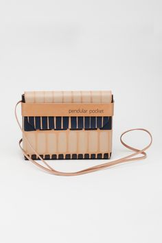 Handcrafted in Berlin by Pendular Pocket, a design studio focused on artisanal leather bag production and creating pieces that will last a lifetime. This crossbody mini bag is handmade with the minima