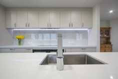 Very large bench area  Bench top: Caesarstone Snow Undermount sink Sink: Heritage Hardware Robiq 400/155