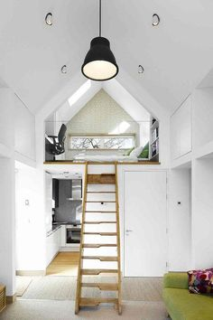 Small White Eco Bedroom - Bedroom Design Ideas  on HOUSE - design, food and travel by House & Garden. Mezzanine level in a garden room with a bedroom and workspace and a kitchen underneath