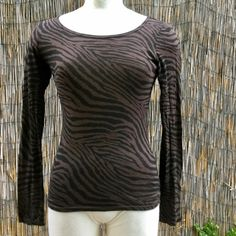NWOT Zebra stripe Express top,  $10 bundled! This adorable top by express has never been worn. It is in excellent condition. It is a size small. The material is supersoft and consists of 52% cotton and 48% modal. OFFER $10 IN BUNDLE! Express Tops Tees - Long Sleeve