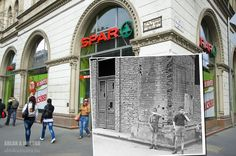 A crumbling brick building from 1958 has been replaced by a modern shop.