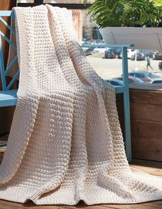 Free Knitting Pattern for Easy Textured Throw - Easy afghan in with an 8-row stitch pattern of knit and purl stitches. Quick knit in chunky yarn. Perfect warm weather throw in cotton yarn. Rated easy by Bernat. I love knitting with the recommended Bernat Maker Home Dec cotton yarn.