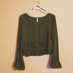 Ruffled Olive Crop Top What a cute top! Olive green with ruffles and bell sleeves. Available in Small, Medium, and Large. Boutique Tops Crop Tops