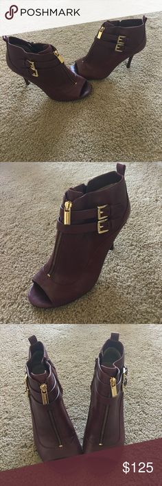 Heels Burgundy MK heels. Shoe very comfortable!only selling because my friend purchased a pair for me as a gift very similar! The leather on the heel is slightly damaged. Heel got caught in between cracks of pavement. Can be repaired at a shoe repair store for less than $10! Heel is 4 inches Michael Kors Shoes Ankle Boots & Booties