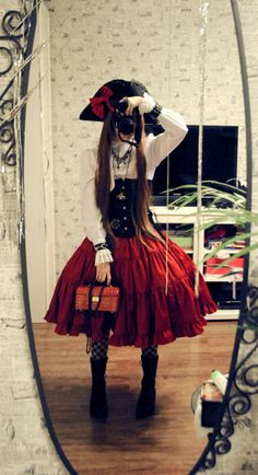Awww.... such a cute little pirate girl outfit.Too bad the little pirate girl is hiding behind her camera..