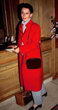 Audrey Hepburn - red coat and loafers