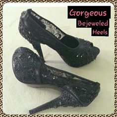 Absolutey Gorgeous Black Bejeweled Heels Absolutey Gorgeous Black Bejeweled Heels with heavy black Rhinestones and scattered sequince! Because of this the shoes are a lil hefty in weight. Protective sleeves included. Great for Prom and Weddings!!! Shoes Heels