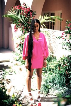 Solange in pink and braids.