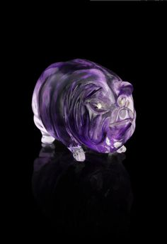 A hardstone model of a pig Fabergé, circa 1900 humorously carved with rose-cut diamond-set eyes; in fitted Wartski case 3 x 4cm (1 3/16 x 1 9/16in).