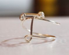 "initial ""T"" wire wrapped ring"