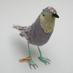 handcrafted birdies by Abigail Brown on etsy today and was simply taken away. Each item is painstakingly detailed with layer upon layer of fabric scraps and tiny hand stitches.
