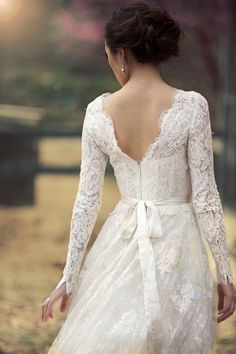 Long sleeve lace wedding dress open back