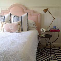 Great mix. Headboard shape, layered nightstands, suzani pillow