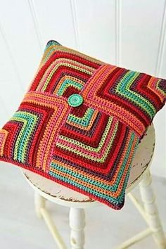 Crochet covers-4 (2)  Again a multi colored cushion is here, circles with a pattern has been made on the cushion. You can place these cushion on the bed as well, no matter what the color of the bed sheet is, these cushions will look just perfect, make them now.