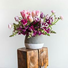 Modern concrete with tulips ranunculus in pink and purple www.labellumflowers.com