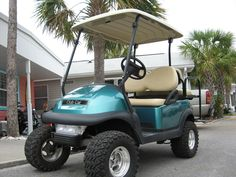 Our custom painted golf cart:)