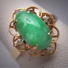 A Gorgeous Antique Green Jade and Diamonds Ring in 14K Gold, Art Deco, estimated circa 1930s. This stunning antique ring holds a beautiful