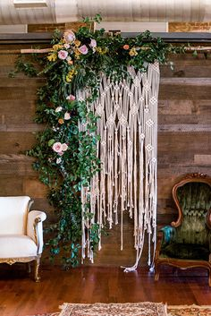 large wedding macrame wall hanging decorated in flowers