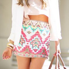 Sequin Mini Skirt Super cute tribal sequin mini skirt! Worn once and in perfect condition, no stains or rips. 95% polyester and 5% spandex outer fabric and 100% polyester inner. This have an extra lining inside as well. No trades  Miami Skirts Mini