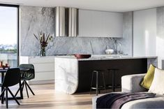 Residential penthouse kitchen by @biasoldesign, featuring one mind-blowing edge detail. Who's inspired to incorporate this designer touch…