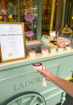 Grape gelato with a macaron on top at Laduree's rue Royal store in Paris.