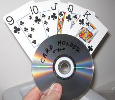 Making a Card Holder from CDs A holder for a hand of cards from a re. Making a Card Holder from CDs A holder for a hand of cards from a recycled CD Making a Card Hol Make Playing Cards, Playing Card Holder, Cd Crafts, Recycled Crafts, Crafts For Kids, Recycled Glass, Cd Diy, Easy Diy Projects, Craft Projects