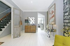 Grey interior design London / whitewashed floorboards / Victorian terrace / grey walls / yellow accent colour / open plan: