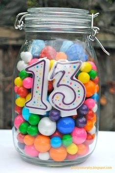 Birthday centerpiece idea for any age -- tie balloons on top--fill with any candy. by valarie