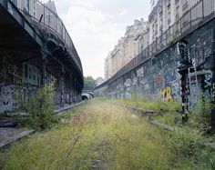 """For his series """"By the Silent Line,"""" French photographer Pierre Folk spent several years documenting the disappearance of the Chemin de fer de Petite Ceinture, a railway in Paris, France Abandoned Buildings, Abandoned Places, Photo Grand Format, Paris Tour, Best Vacation Destinations, Cities, Old Paris, Paris 3, Paris France"""