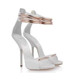 E30225 001  $ 1,350.00    Elegance and minimalism combine seamlessly in these ostrich leg print leather sandals lit up by the slender geometric lines of a copper colored metal ankle strap.