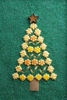 Get a burst of citrus flavor with the addition of both clementine and lemon zest in this citrus spritz cookie recipe. #spritzcookies #bestspritzcookies #christmascookies #bhg